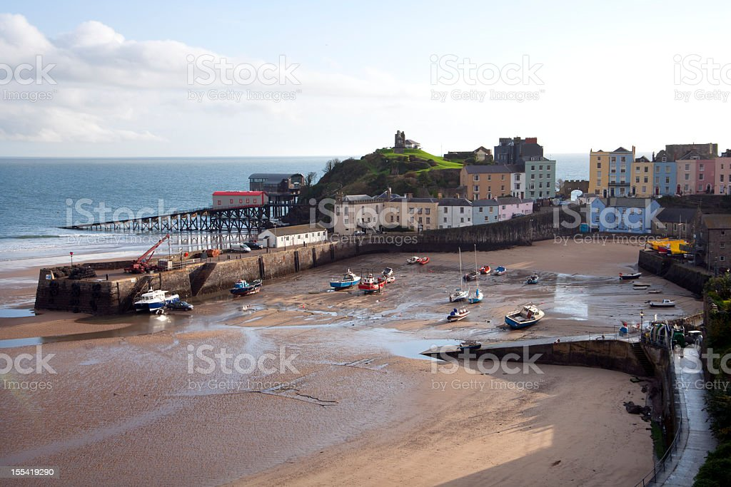 UK, Pembrokeshire, Tenby, houses around the harbour at low tide royalty-free stock photo