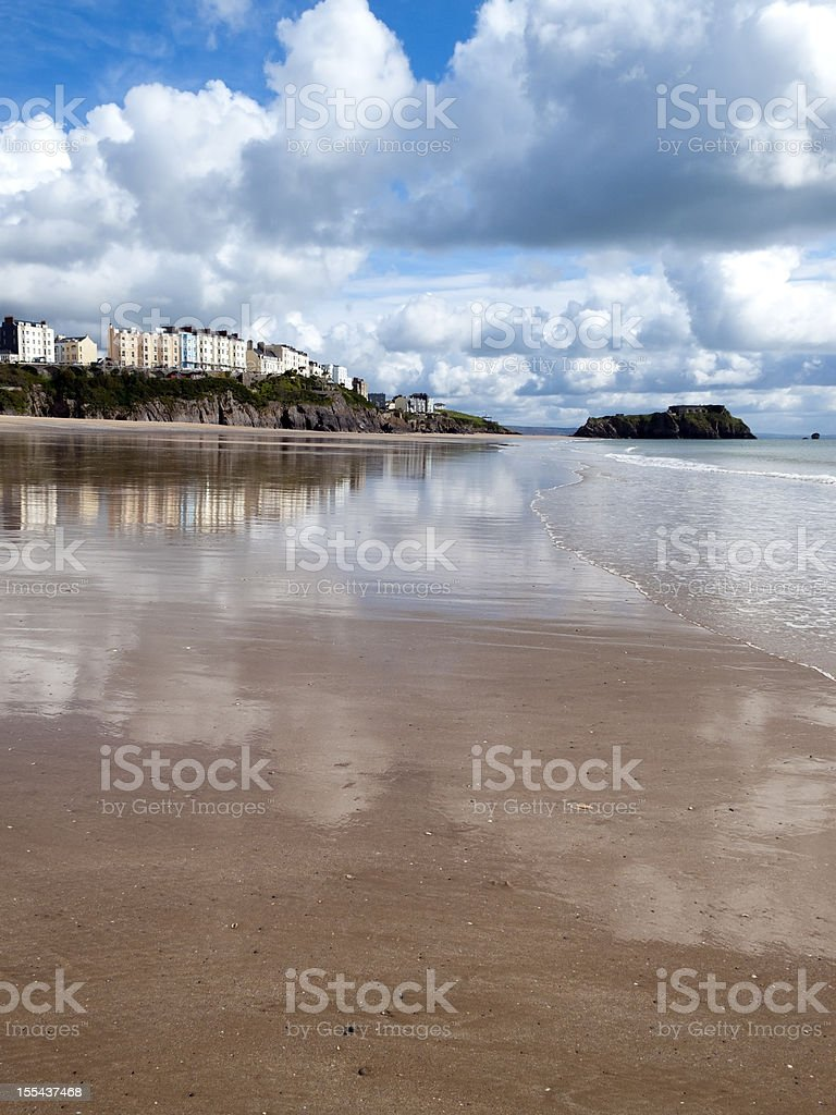UK, Pembrokeshire, Tenby reflected in wet sand of South Beach stock photo
