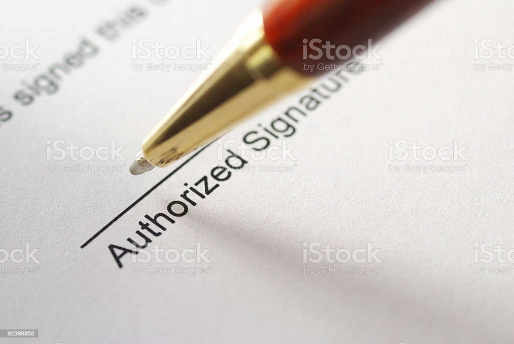 A pen about to sign a contract stock photo