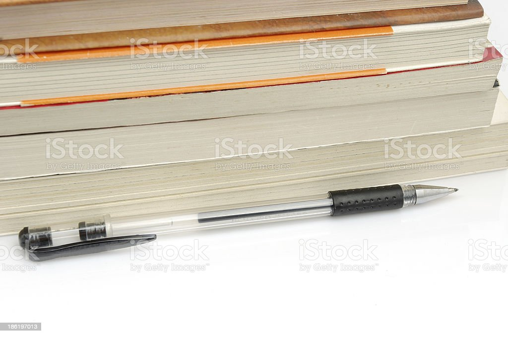 Pen and book royalty-free stock photo
