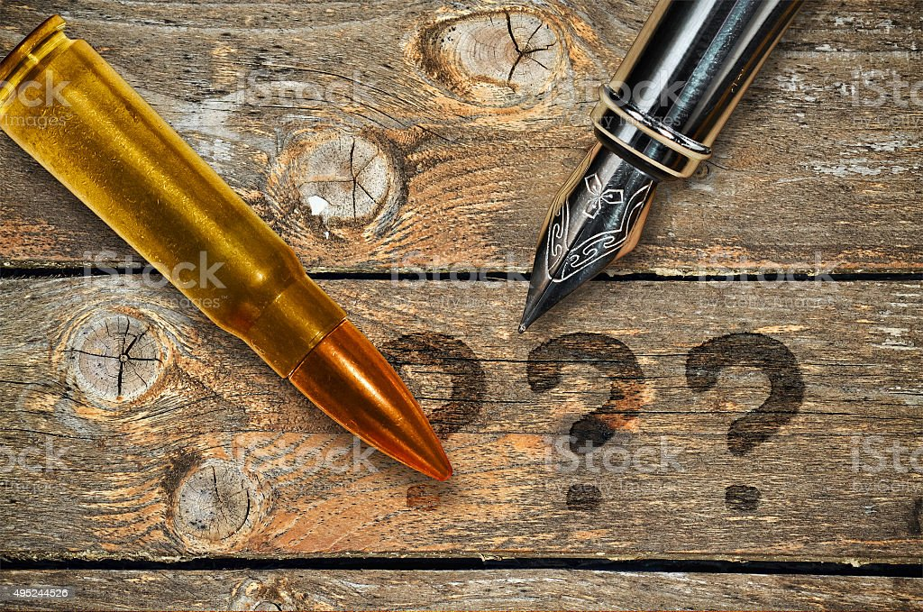 Pen and bullet stock photo