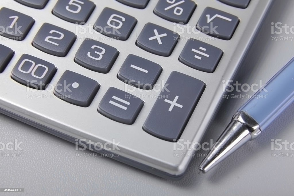 pen and calculator on business paper stock photo