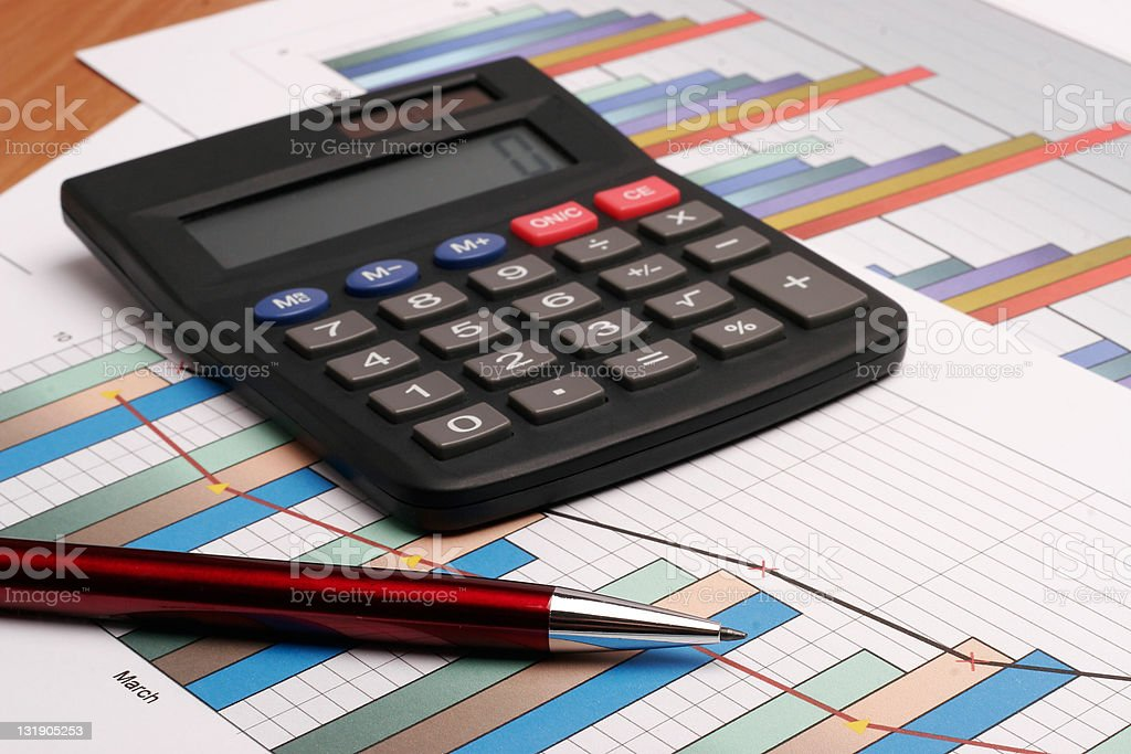 Pen and calculator on graph #3 royalty-free stock photo
