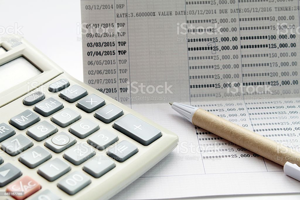 Pen And Calculator On Savings Account Passbook Stock Photo