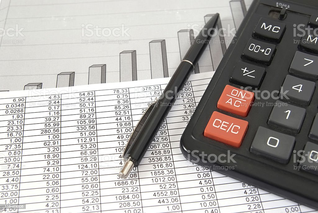 Pen and calculator stock photo