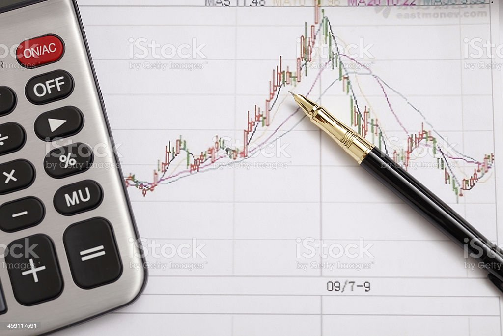 Pen and financial statements royalty-free stock photo