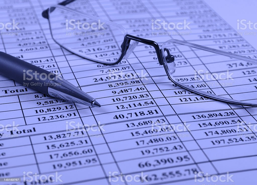 Pen and glasses on financial report royalty-free stock photo