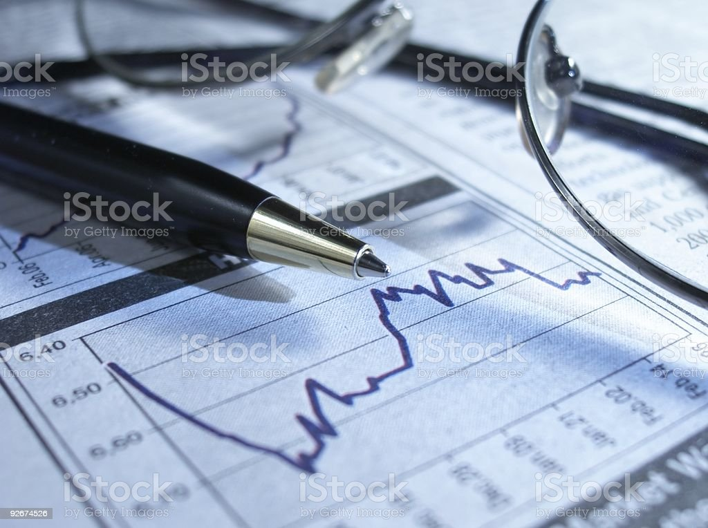Pen and glasses on stock chart. royalty-free stock photo