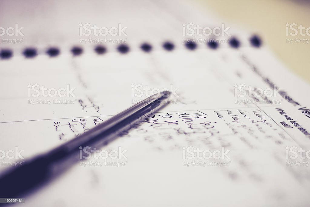 Pen and guestbook with handwriting stock photo