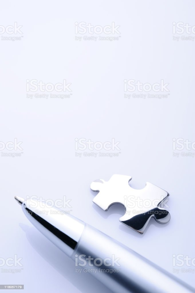 Pen and jigsaw piece stock photo