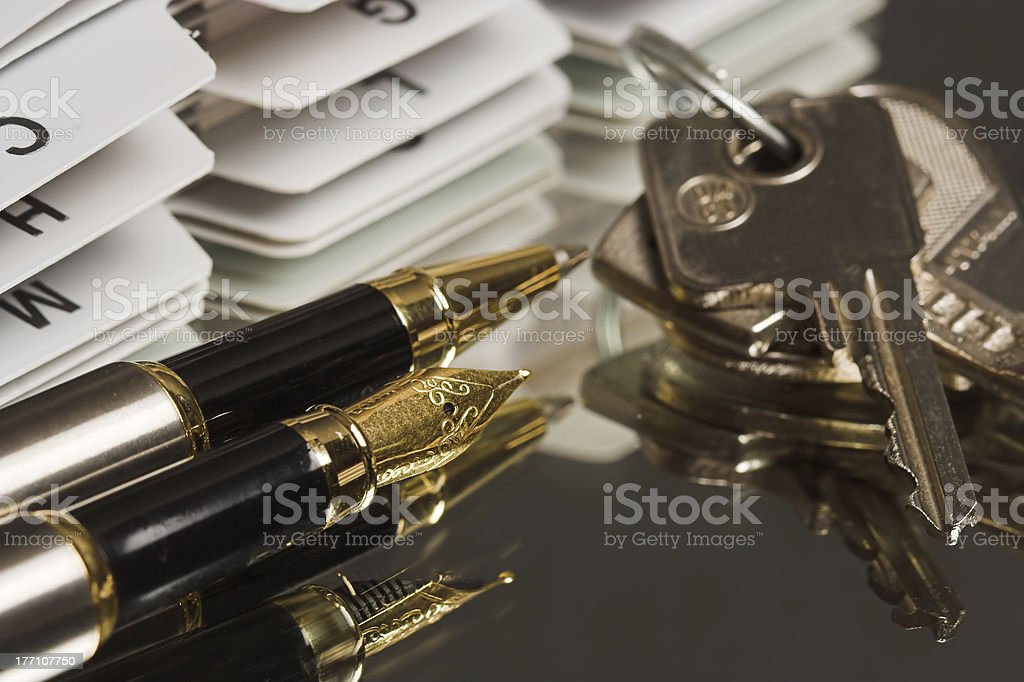 Pen and keys stock photo