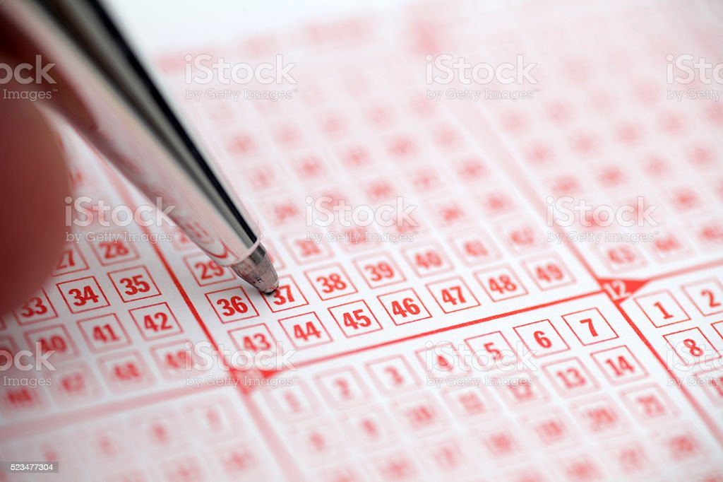 Pen and lottery ticket stock photo
