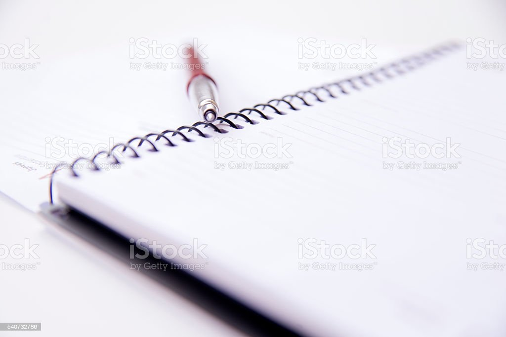 Pen and notebook, isolated on white background stock photo