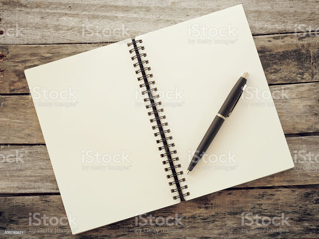 pen and notebook old retro vintage style stock photo