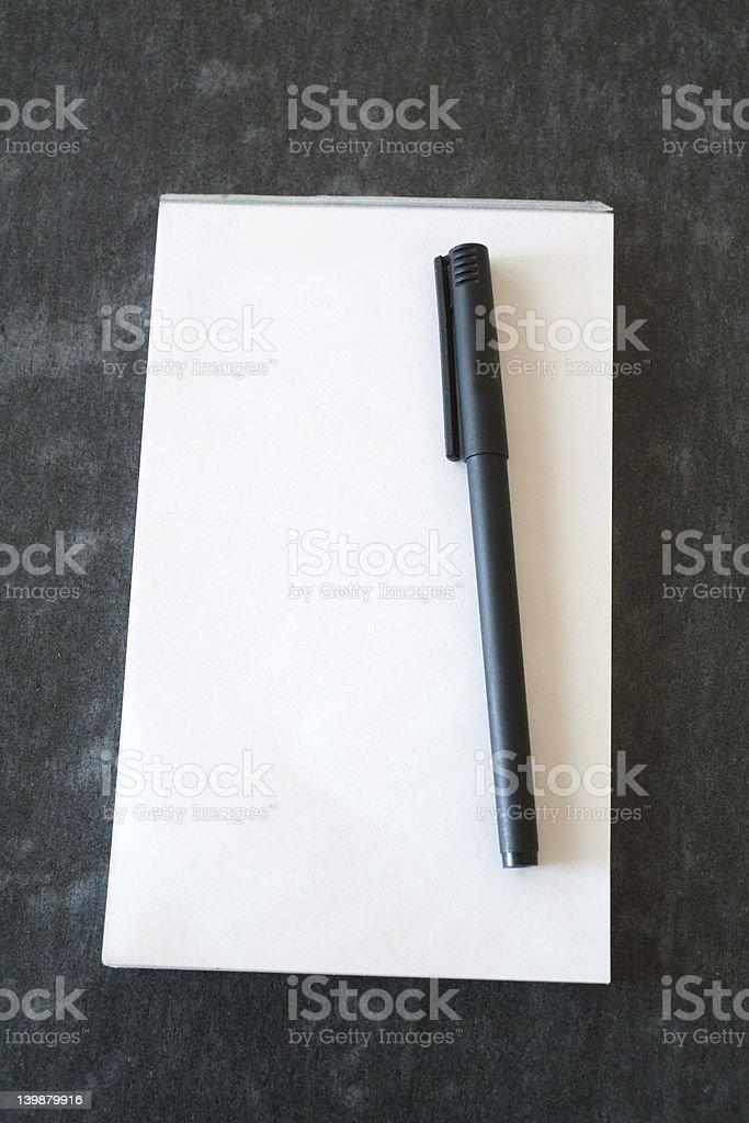 pen and pad on desk stock photo