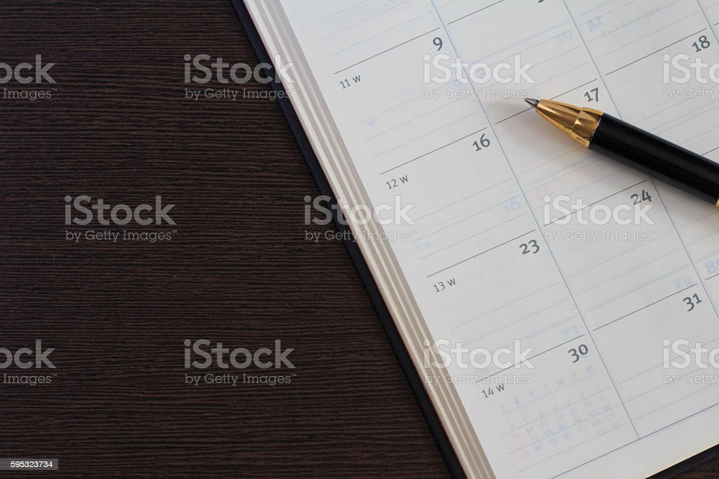 Pen and schedule book stock photo