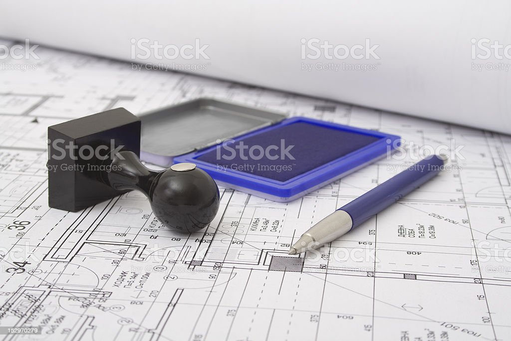 Pen And Stamp On Drawing royalty-free stock photo