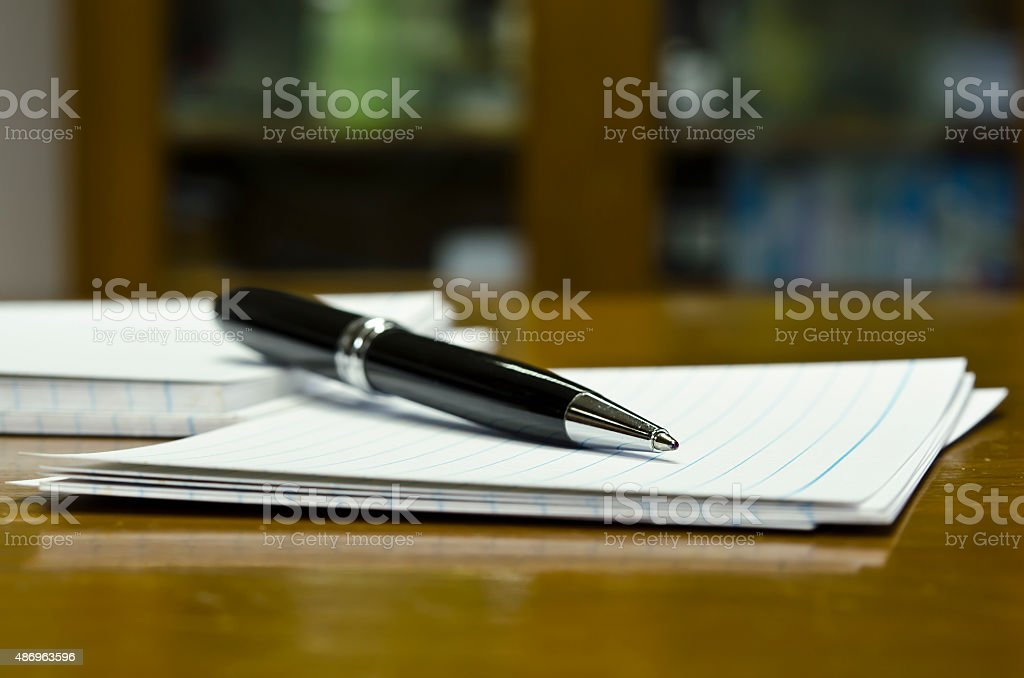 Pen and white paper close-up view stock photo