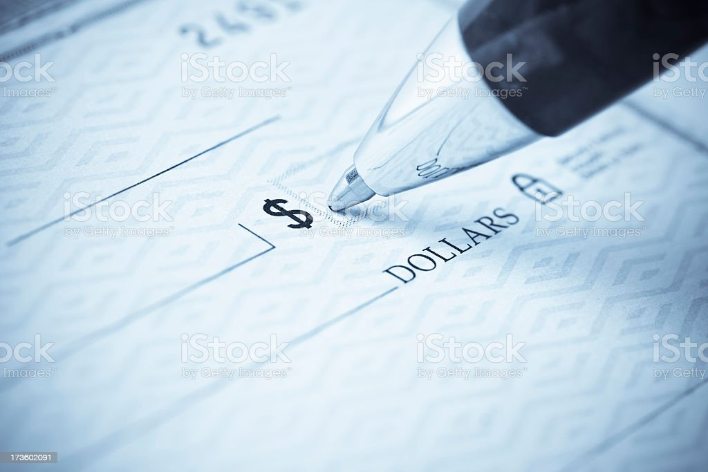 Pen being used to write a check stock photo