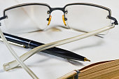 Pen book and glasses