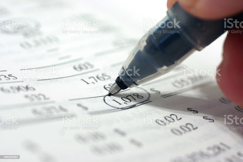 Pen drawing a circle around a total of 1078 on a spreadsheet royalty-free stock photo