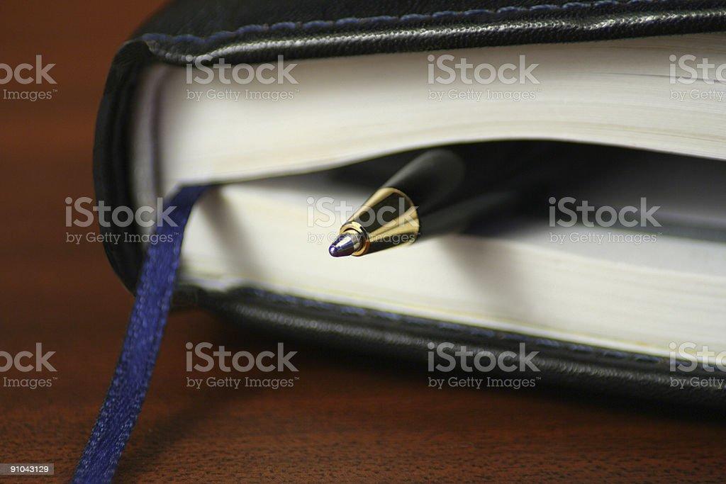 pen in notebook stock photo