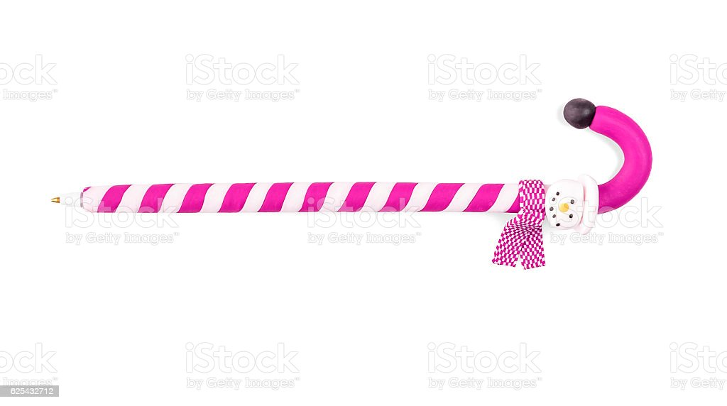 Pen in the shape of a Christmas candy. stock photo
