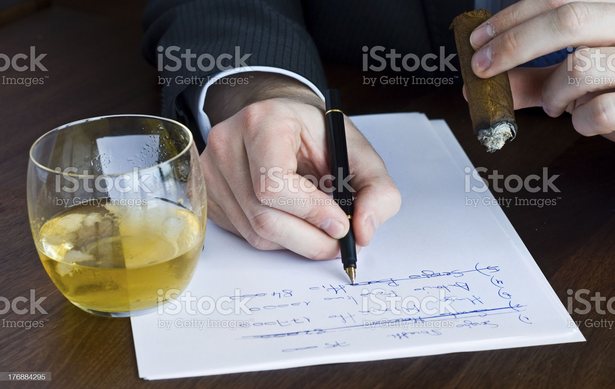 pen in writing hand and  wishky royalty-free stock photo