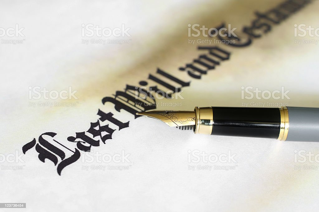 Pen laying on paper that states Last Will and Testament royalty-free stock photo