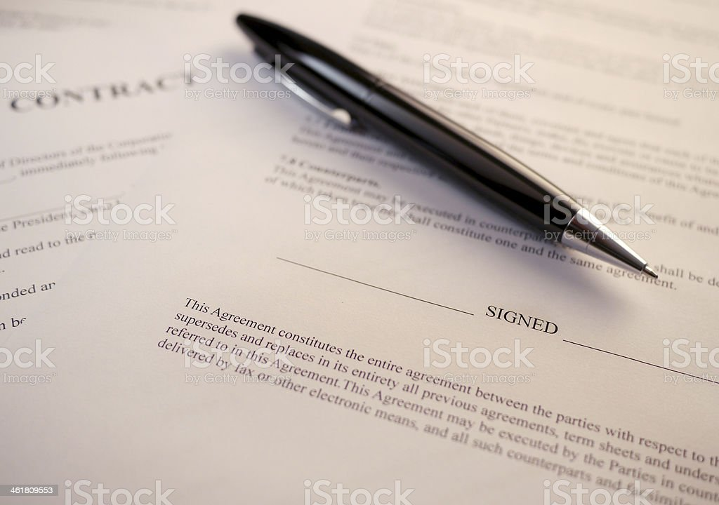 pen lying on a contract stock photo