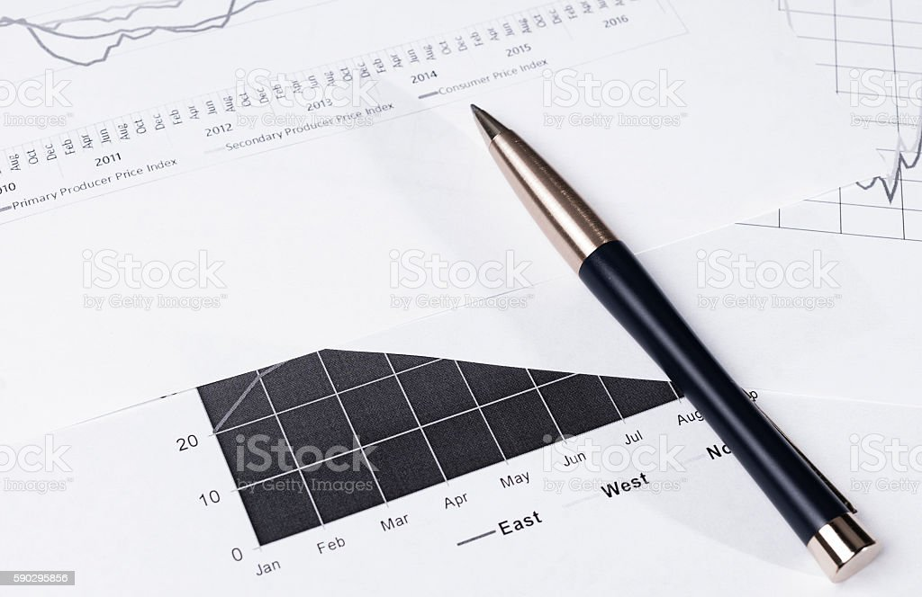 Pen lying on financial statements. Business Background stock photo