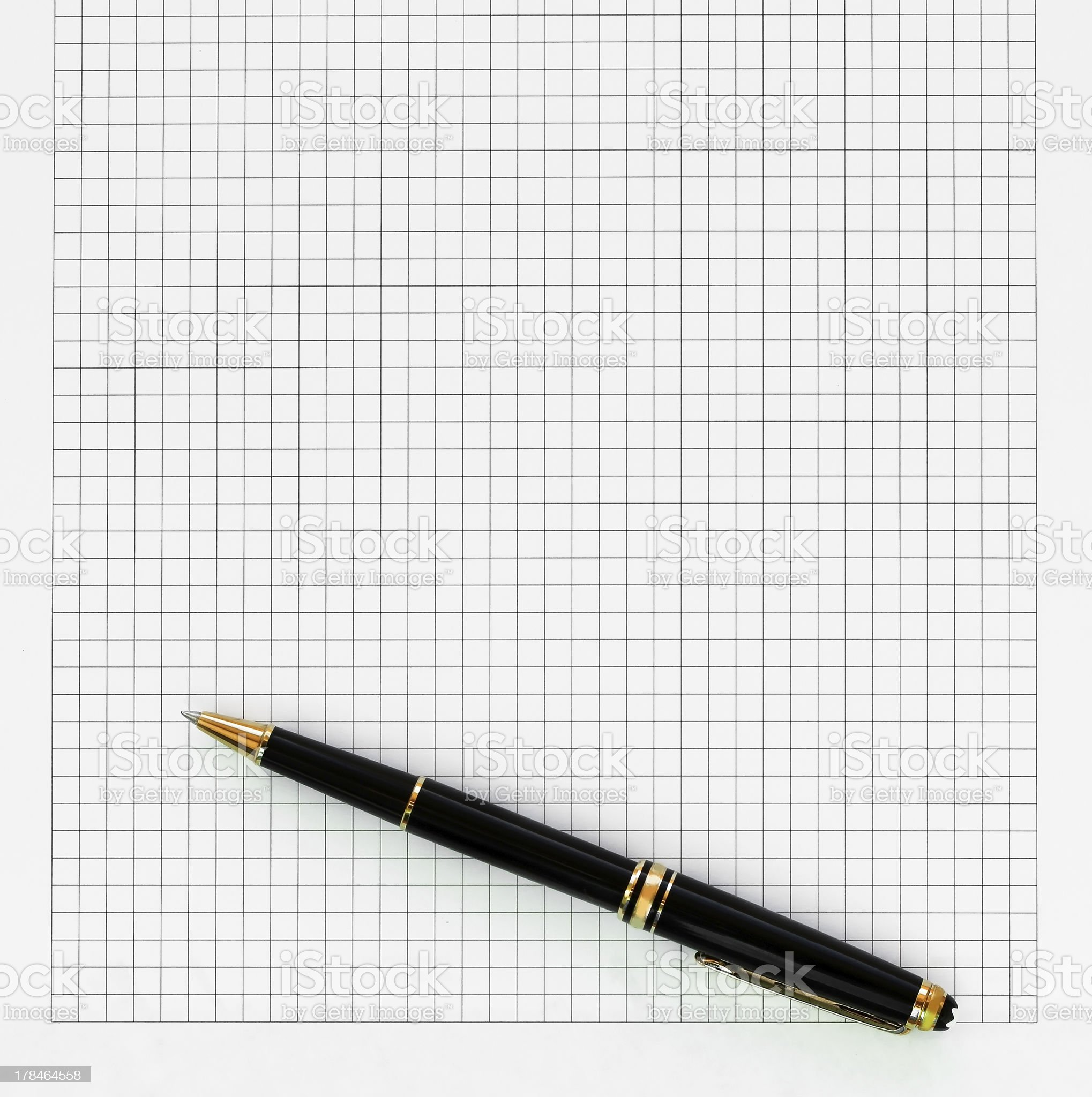 Pen lying on the white sheet into cell royalty-free stock photo