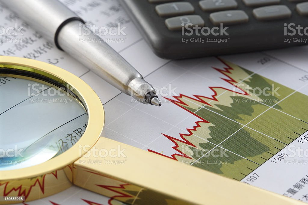 Pen, Magnifier and Calculator on Financial Statement royalty-free stock photo
