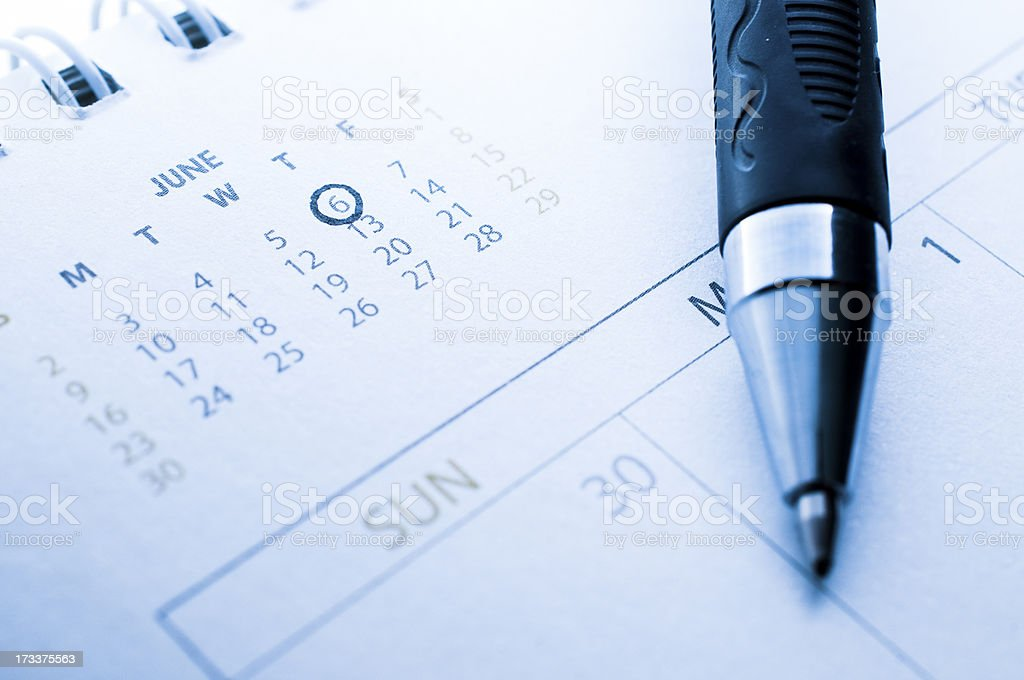 pen marked day on the calendar royalty-free stock photo