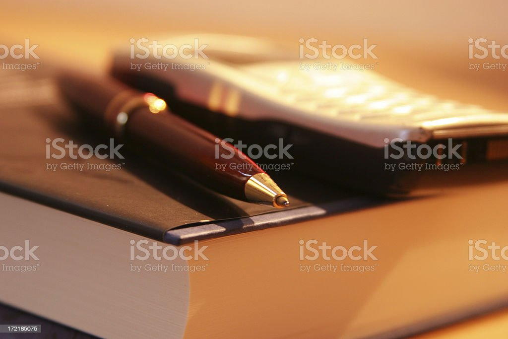 Pen, mobile phone & book royalty-free stock photo