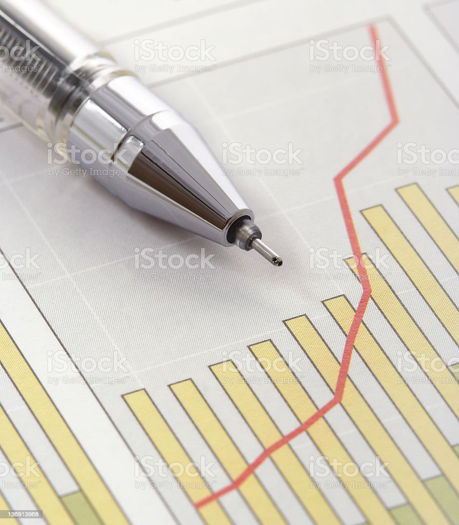Pen on a bar and line positive earnings graph royalty-free stock photo