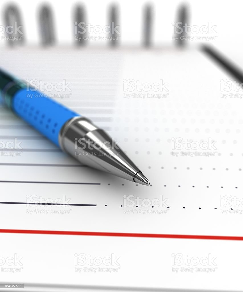 Pen on a notebook royalty-free stock photo