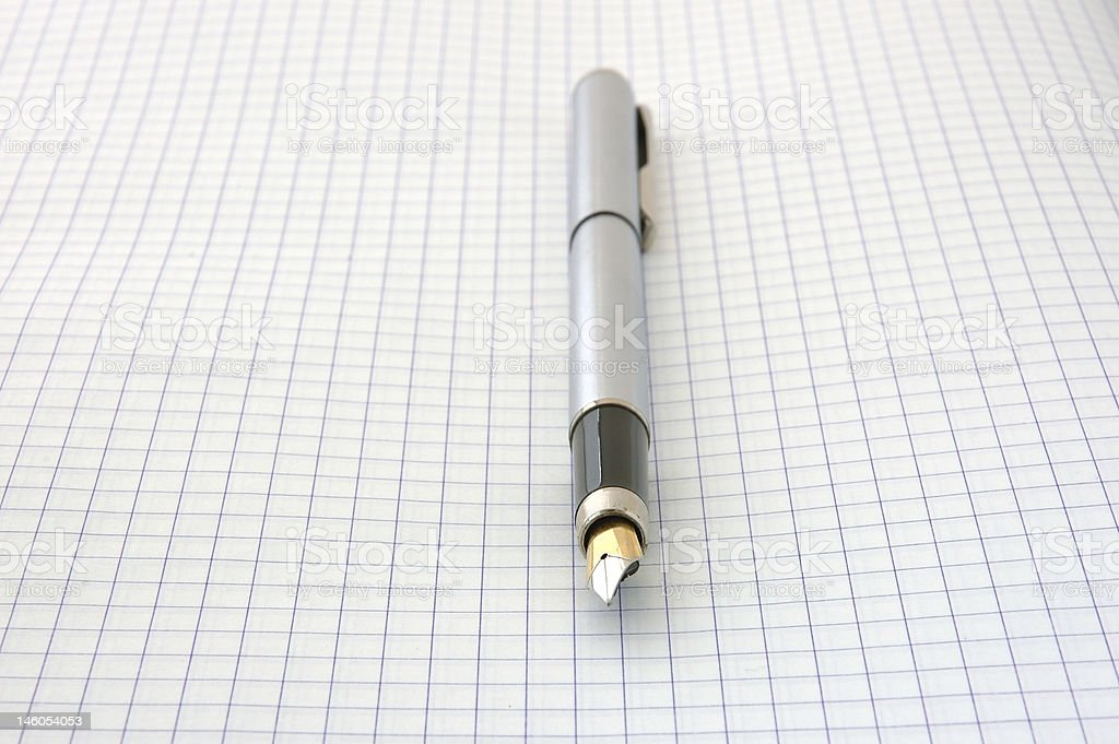 Pen on blank squared paper royalty-free stock photo