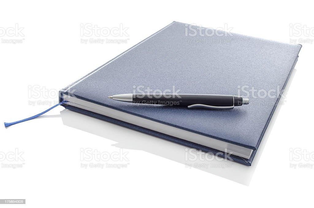 Pen on blue notebook stock photo