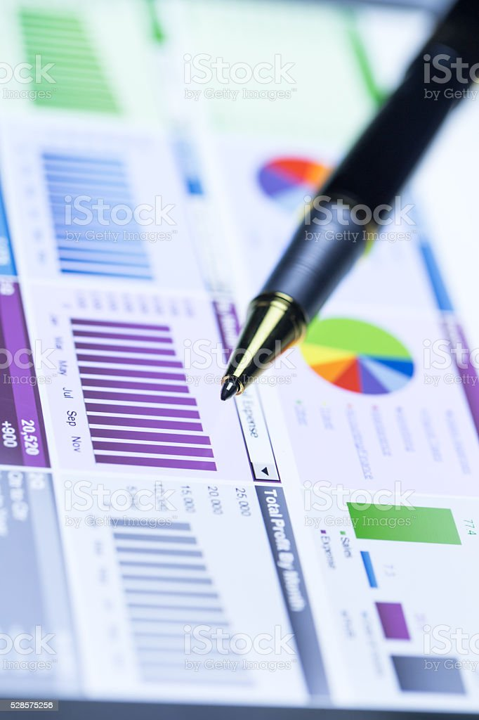 pen on data report show on touchpad stock photo