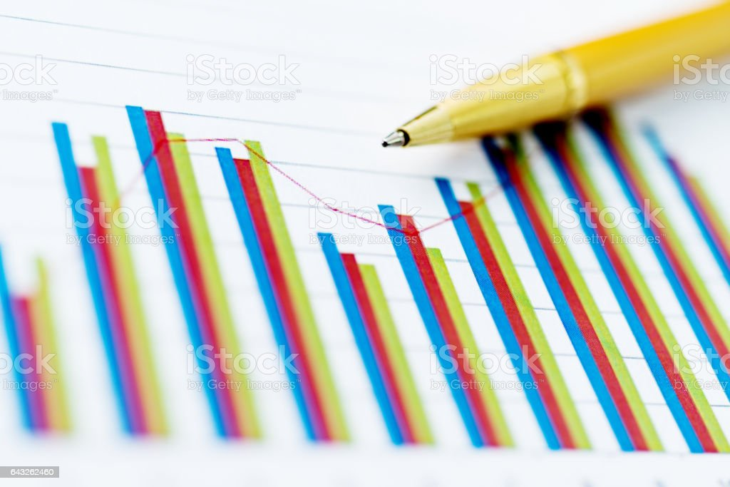 Pen on financial graphs and charts stock photo