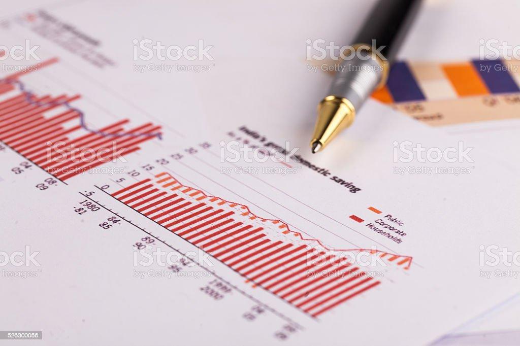 pen on histogram graph stock photo