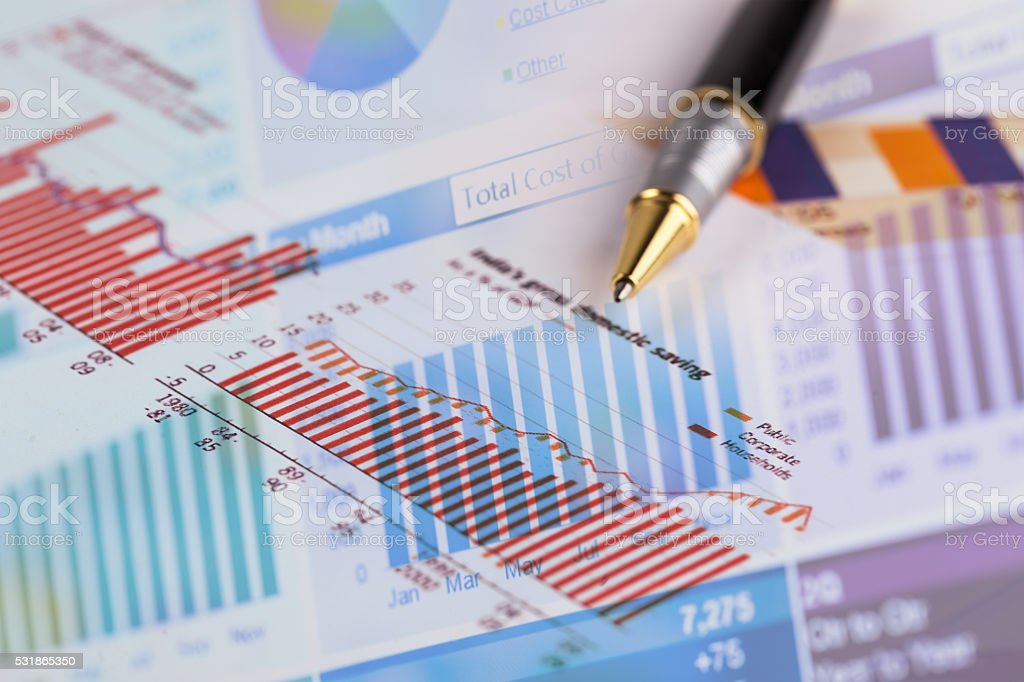 pen on histogram graph stock photo