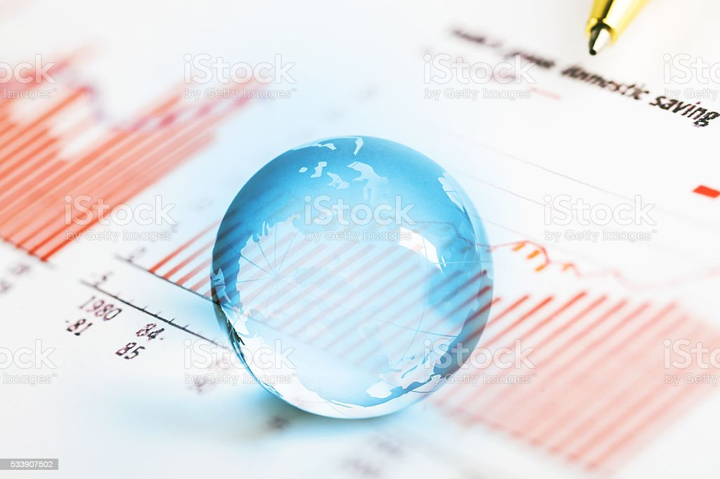 pen on histogram graph with crystal global ball stock photo