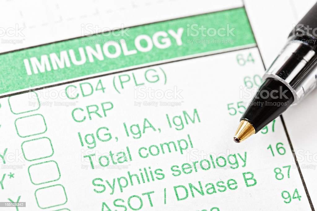 Pen on Immunology form for blood tests stock photo