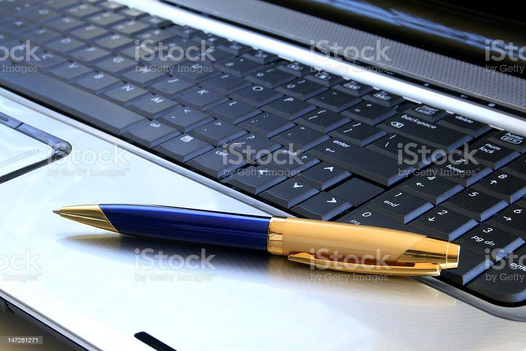 Pen on keyboard. royalty-free stock photo