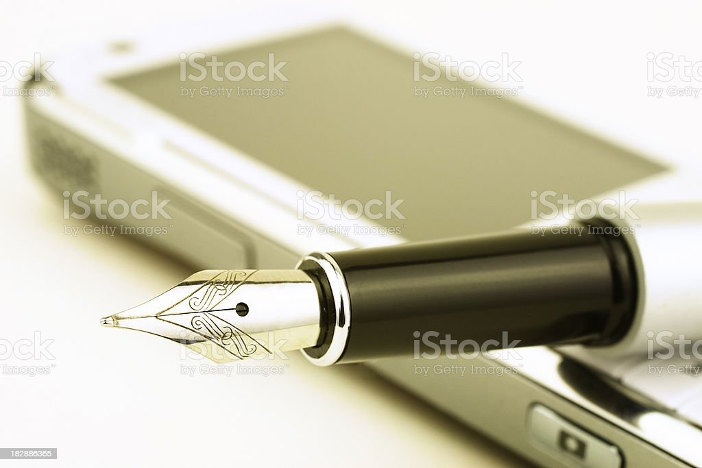 Pen on mobile phone royalty-free stock photo