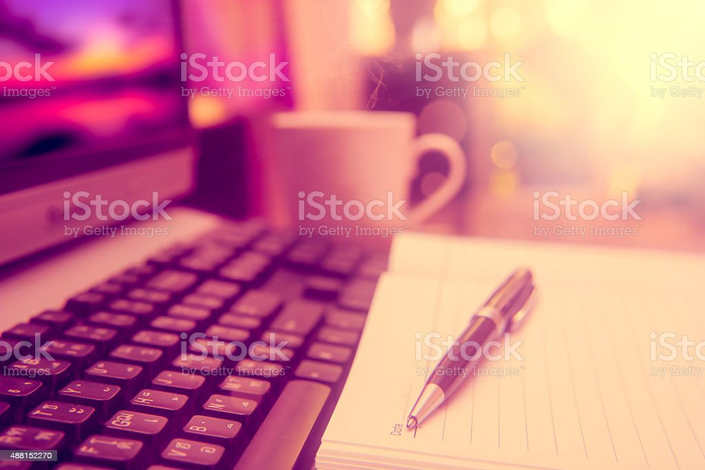 Pen on notebook and computer. stock photo