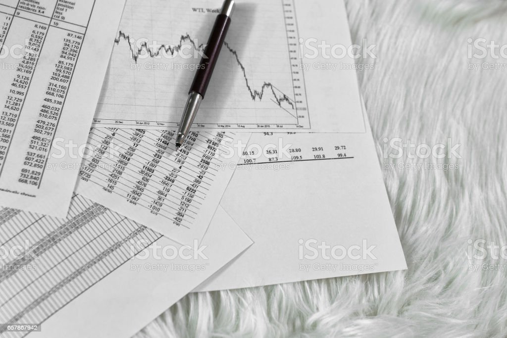 pen on paper with the price quotes and charts stock photo