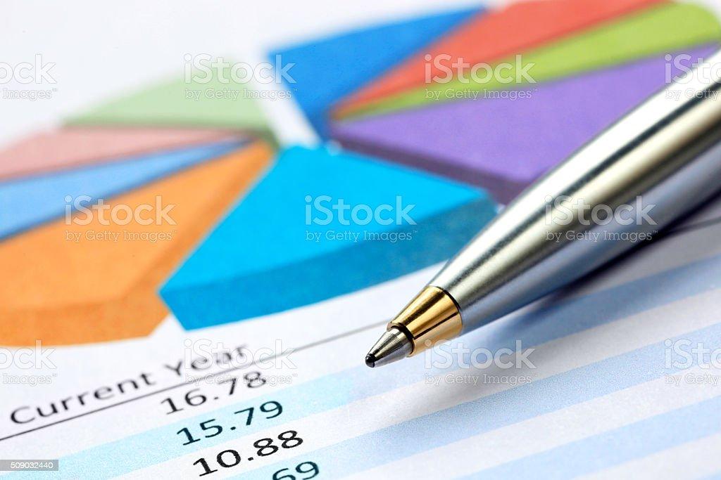 Pen on Pie Chart stock photo